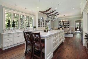 white marble kitchen with wooden plants